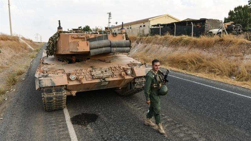 Turkey urges US to ensure pullout of Kurdish forces under deal